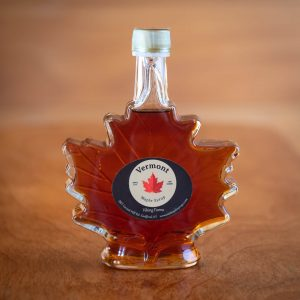 Pure maple syrup in a leaf shaped bottle.