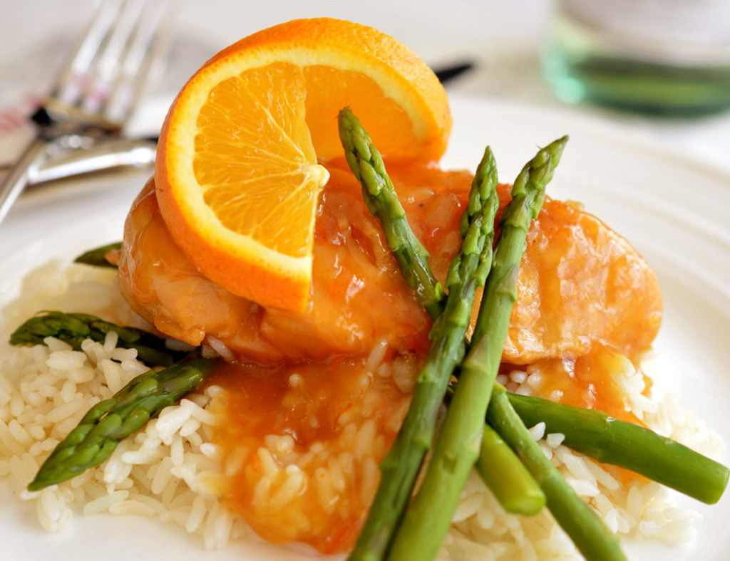 Maple Chicken with Oranges on cooked rice with asparagus.