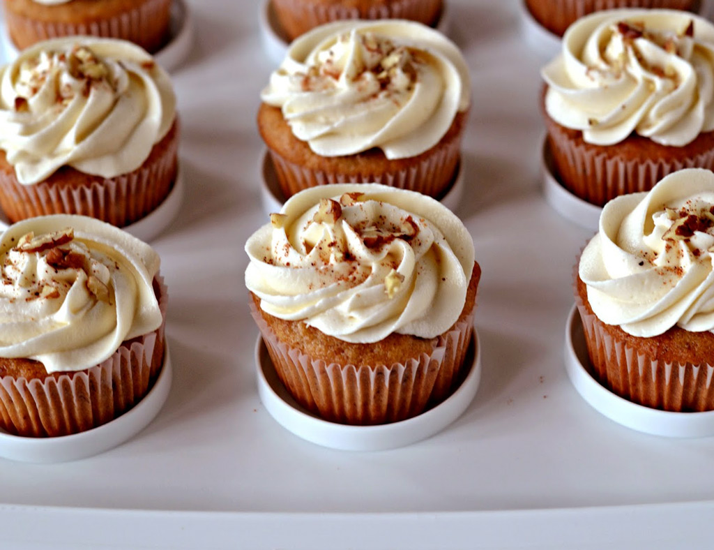 Six Extra Maple Cupcakes with beautiful maple frosting and chopped walnuts.
