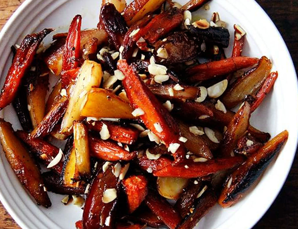 White bowl filled with Roasted Maple Vegetables.
