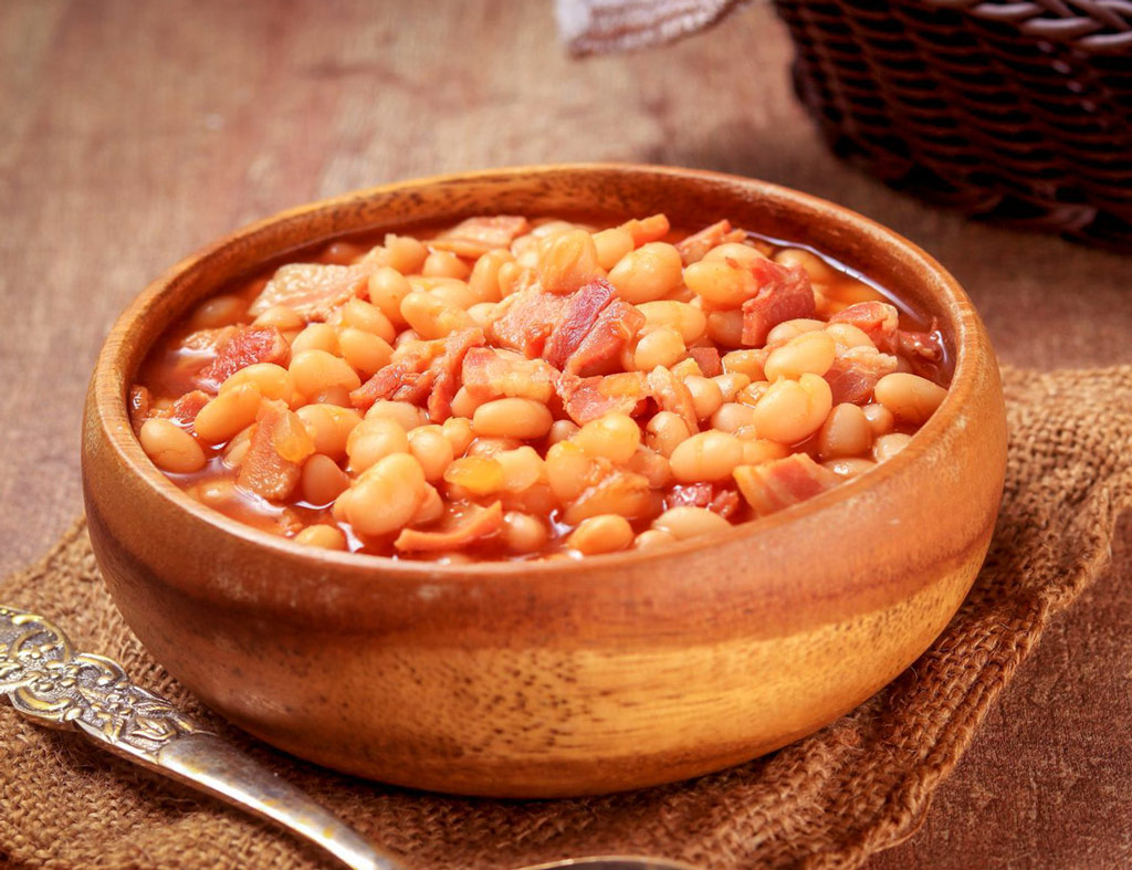 A bowl with juicy Baked Maple Beans.