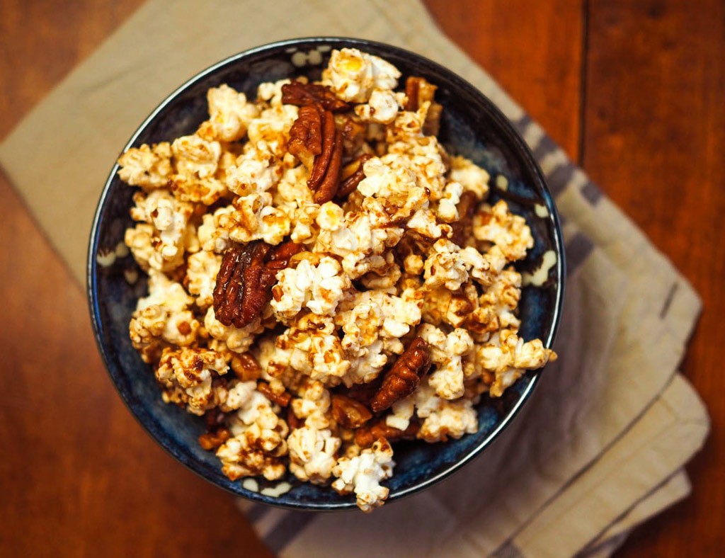 A bowl full of Maple-Pecan Popcorn.