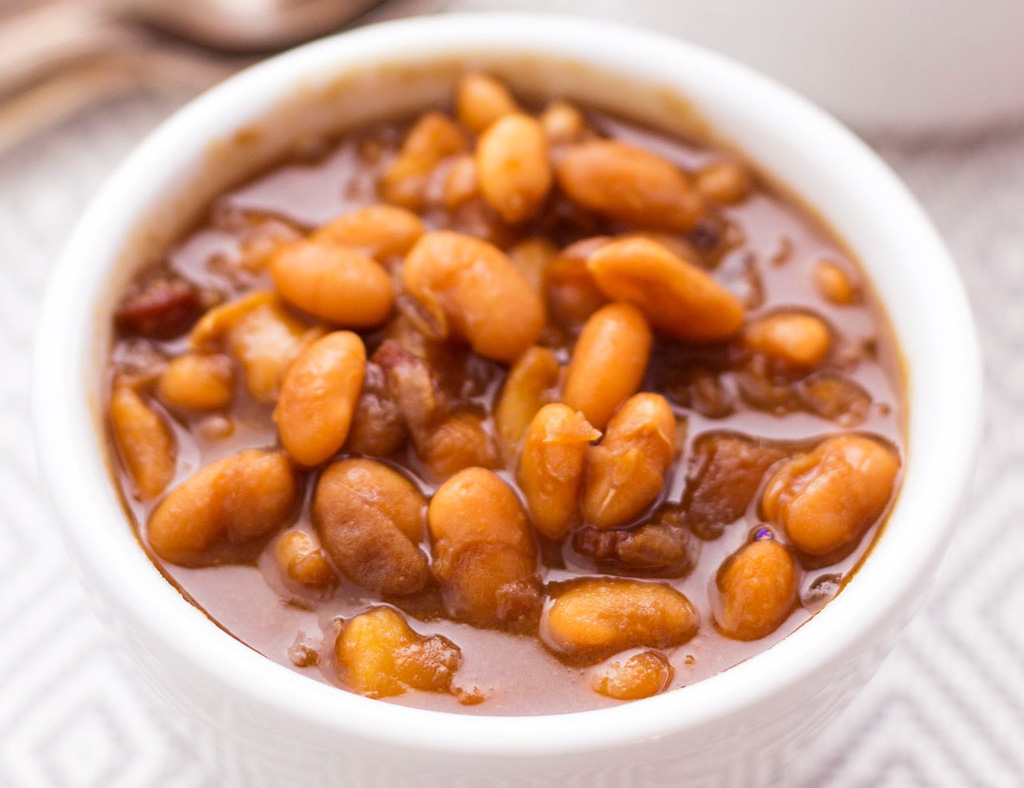 A white bowl filled with Smoky Beans.