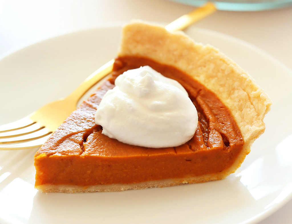 A beautiful piece of Sweet Potato Pie with Ice Cream on the plate.